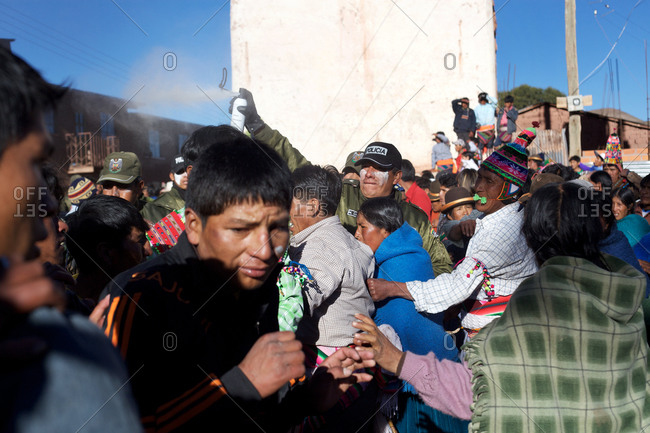 Macha, Bolivia - May 5, 2010: Police use tear gas to disperse villagers as fighting gets out of control between rival villages during the Tinku Festival in Macha, Bolivia
