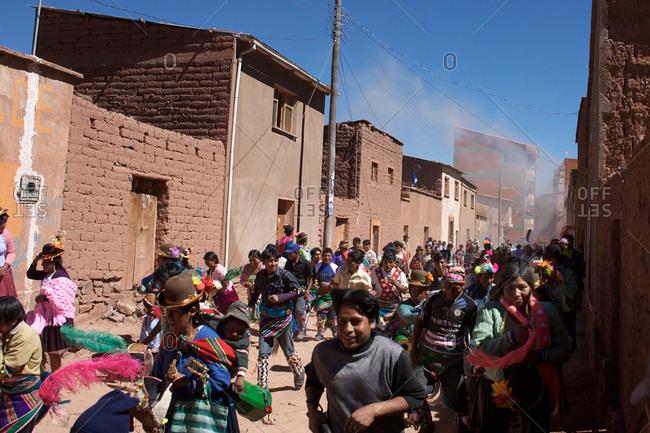 Macha, Bolivia - May 4, 2010: Villagers run away during Tinku Festival in Macha, Bolivia