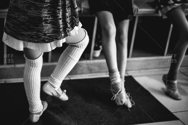 Legs of three girls in a ballet shoes
