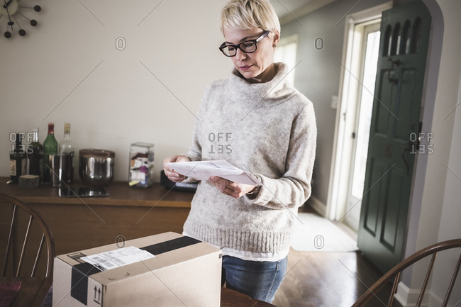 Woman sorting through mail