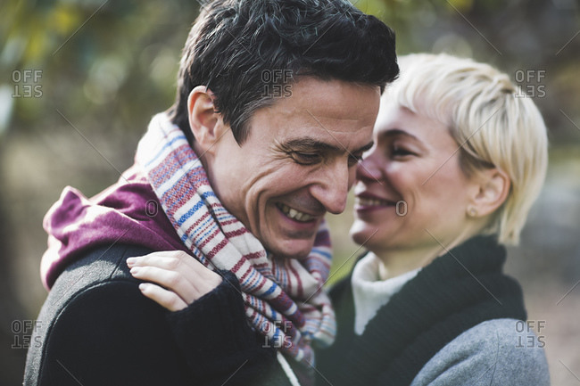 Couple in scarves laughing