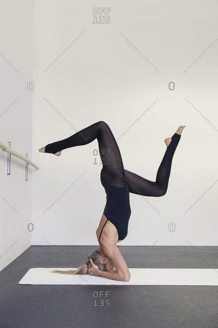 Woman doing headstand in yoga