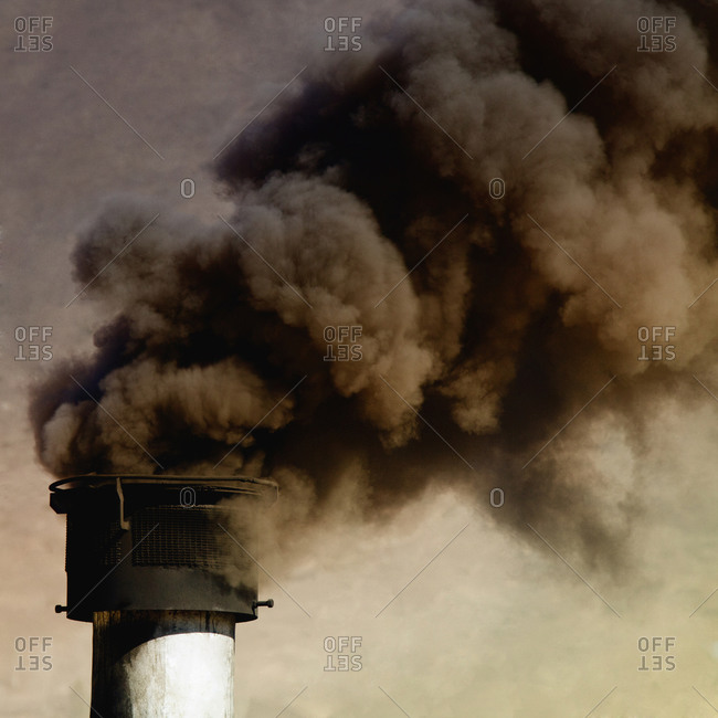 Close up of smoke billowing from smoke stack