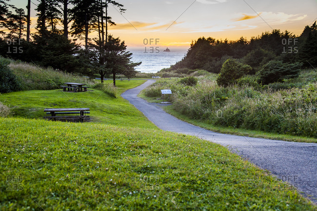 Path in park overlooking sunset and ocean