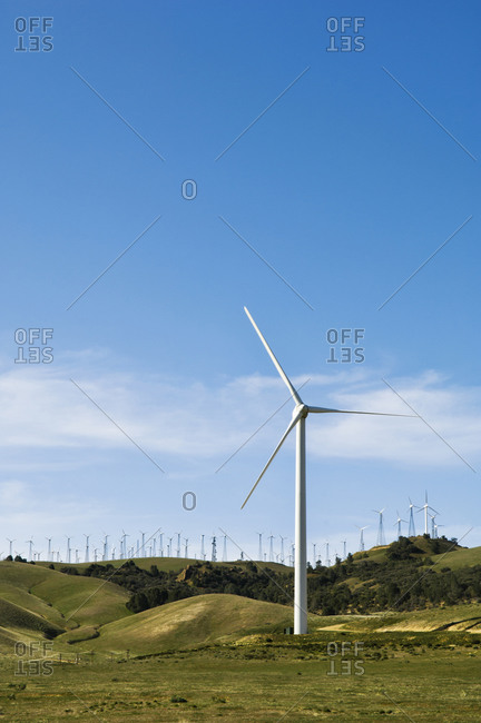 Wind turbines on hilltop in rolling landscape