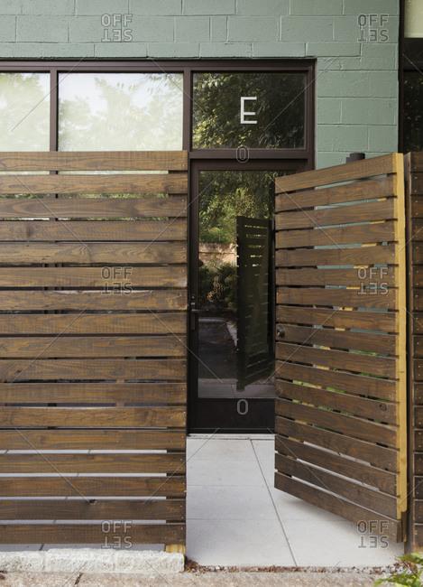 Wooden entrance to modern condo building