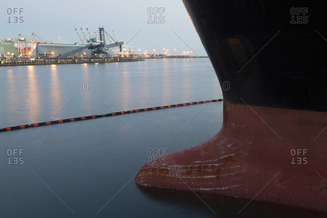 Close up of bow of a large ship docked in harbor