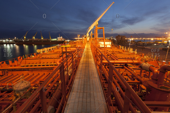High angle view of deck piping on oil tanker ship at twilight