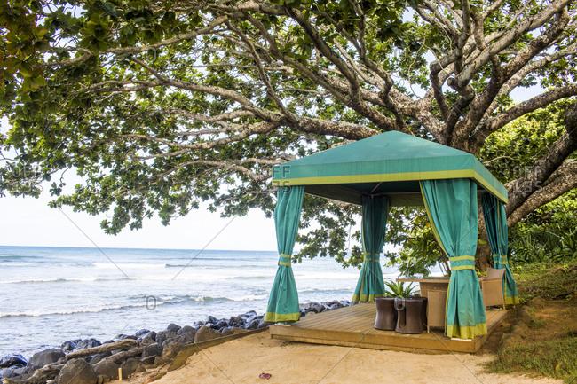 Cabana on sandy beach overlooking ocean