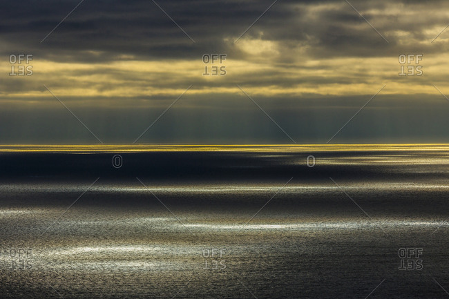 Sunbeams shining over ocean seascape