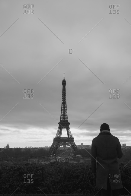 Man looking at the Eiffel Tower from Trocadero, Paris