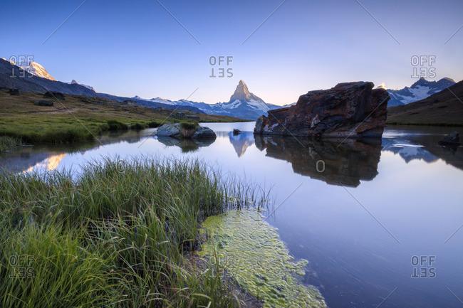 Matterhorn lake reflection at dawn, Switzerland