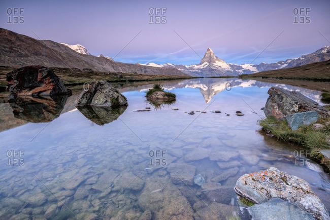 Matterhorn lake reflection, dawn, Switzerland