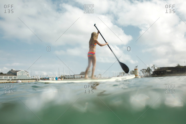 Girl paddling on a paddle board