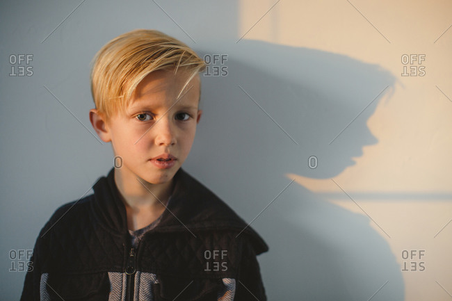 Portrait of a little boy with a shadow