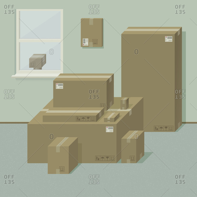 Stack of cardboard boxes sitting in a room