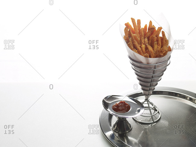 French fries and ketchup on tray