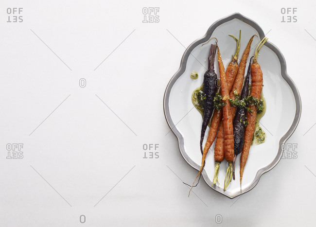 Cooked whole carrots on platter
