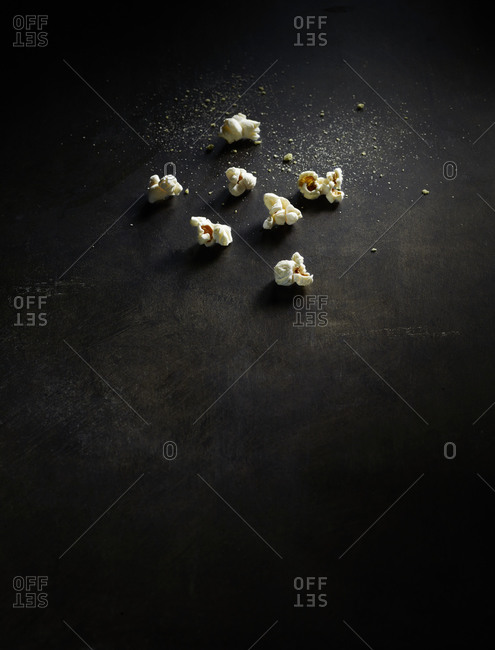 Popcorn kernels on dark background