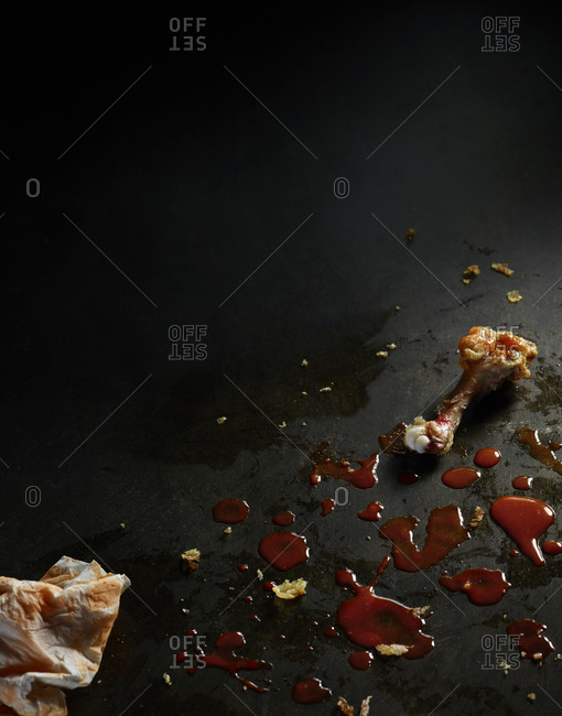 Chicken wing and sauce splatters