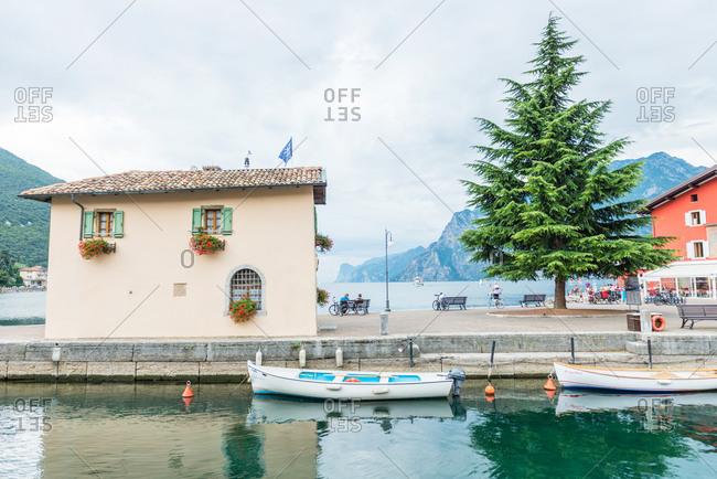 Fishing boats in the harbor in Riva del Garda, Italy