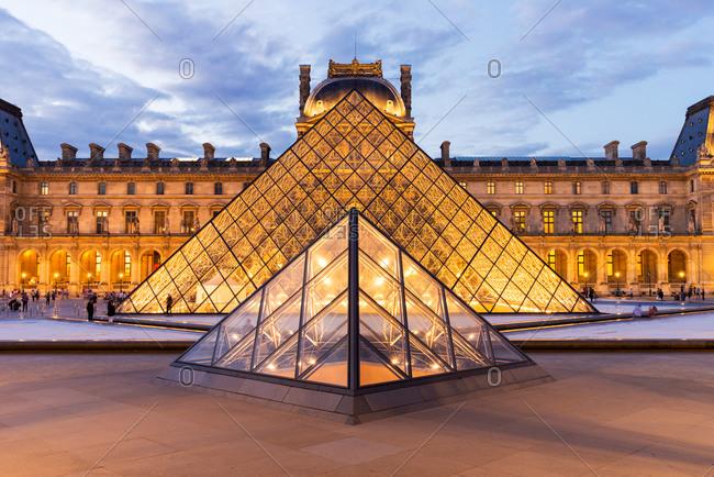Two Louvre Pyramids illuminated at twilight, Paris