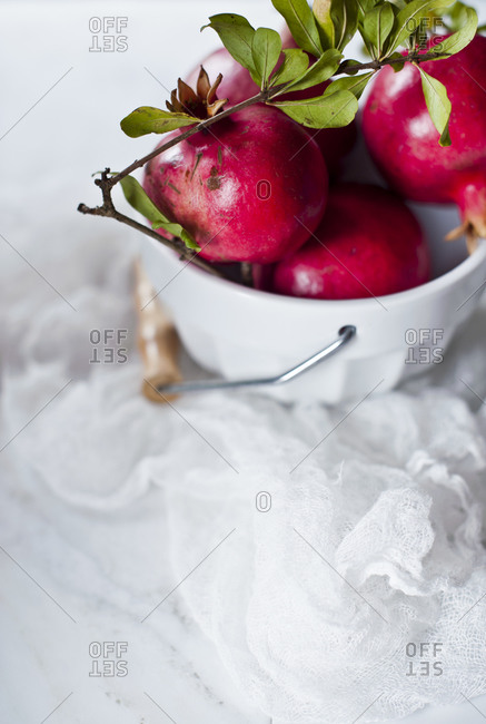 Pomegranates in a white bowl