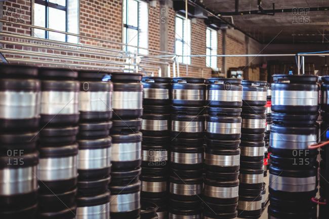 Several stacks of beer barrels at a local brewery