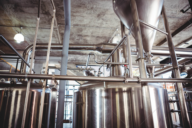Large stainless steel vats of beer at microbrewery