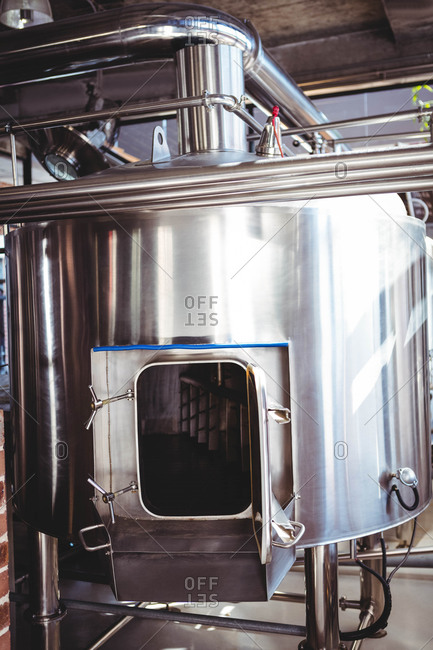 Large silver vat of beer at microbrewery
