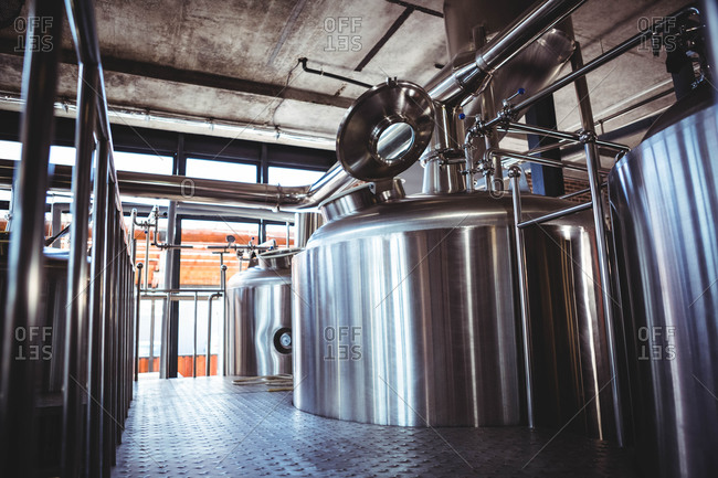 Large metal vats of beer at microbrewery