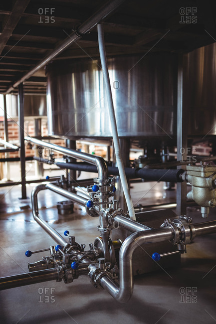 Large steel vats of beer at microbrewery