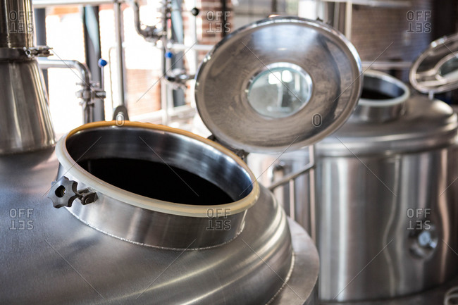 Close up of open door on large vats of beer at the local brewery