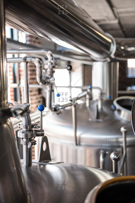 Close up of large vats of beer at the local brewery