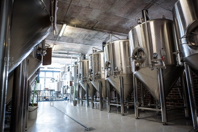 Several large vats filled with beer at the local brewery