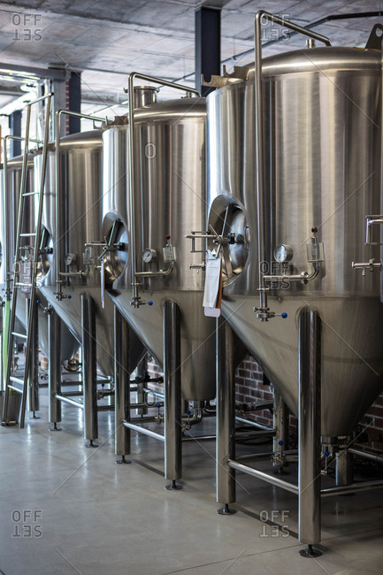 Large vats filled with beer at the local brewery