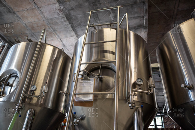 Low angle view of large vats filled with beer at the local brewery