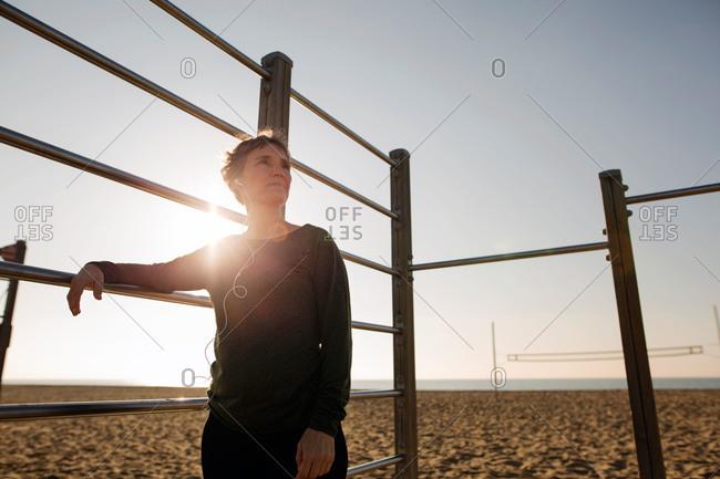 Athletic woman gazing off on beach