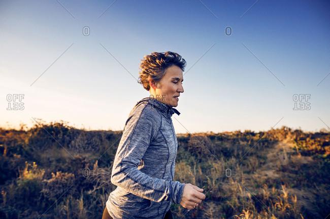 Woman jogging in a coastal area