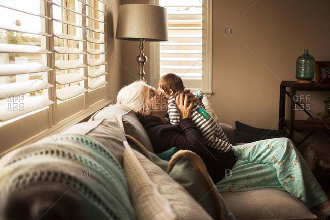 Grandma holding newborn on couch