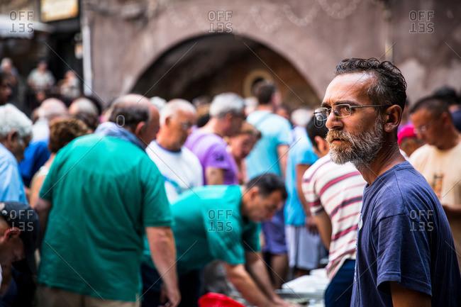 Catania, Sicily - July 25, 2015: Busy fish market in Catania, Sicily