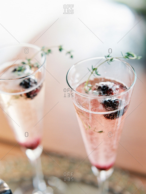 Champagne with blackberries and thyme
