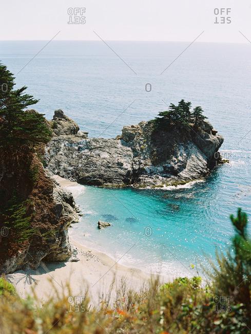 Bright blue waters in a rocky sea cove