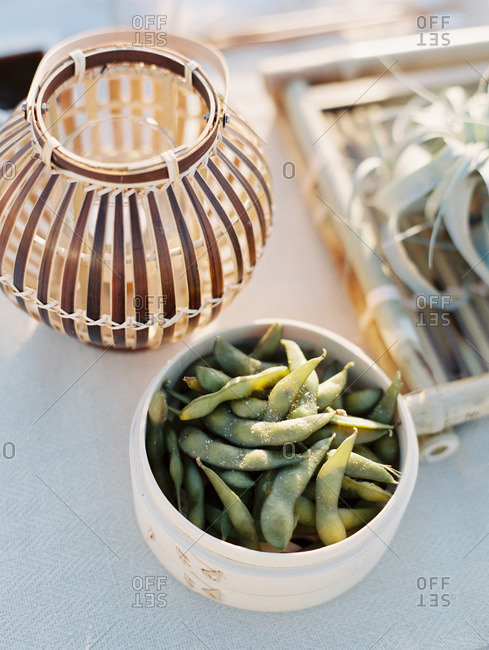 Edamame in a wooden food container at an outdoor picnic