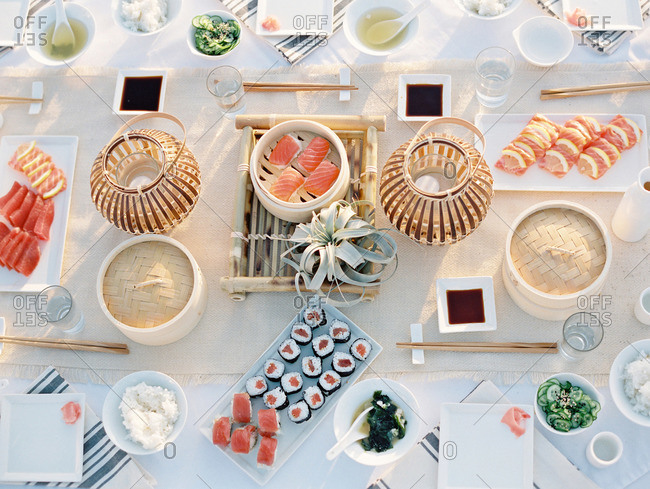 Sushi dishes spread on an outdoor table