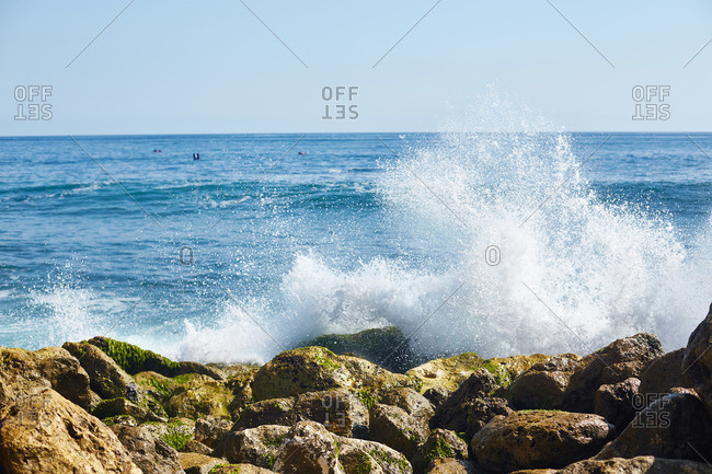 Waves crashing on rocky beach