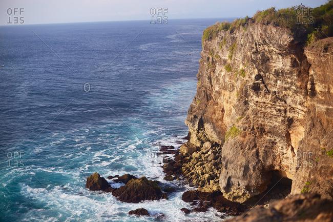 Steep rocky cliff along coastline