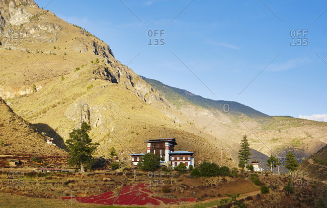 Building nestled at the base of a steep mountain