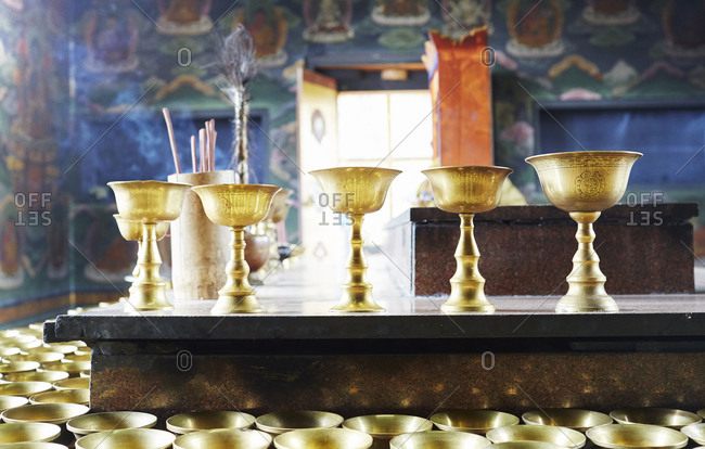 Gold chalices on an altar in a temple
