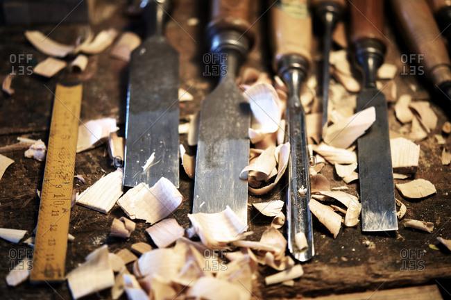 Chisels, measuring tape, wood shavings